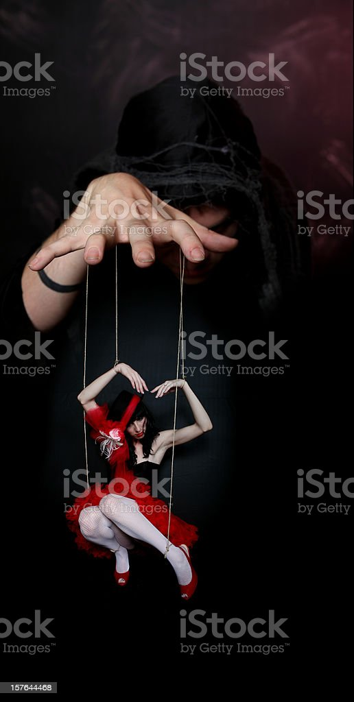 Evil Puppeteer royalty-free stock photo