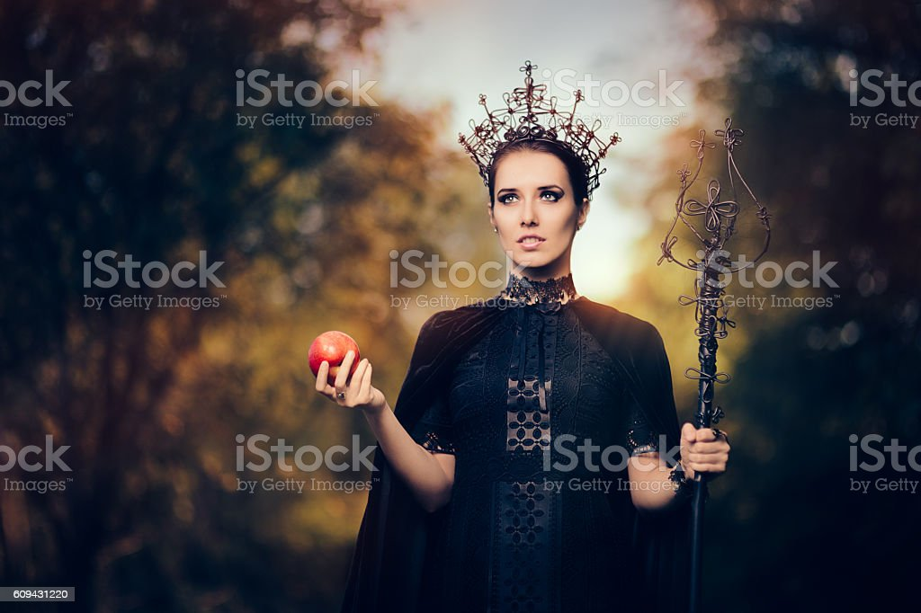 Evil Queen with Poisoned  Apple in Fantasy Portrait stock photo