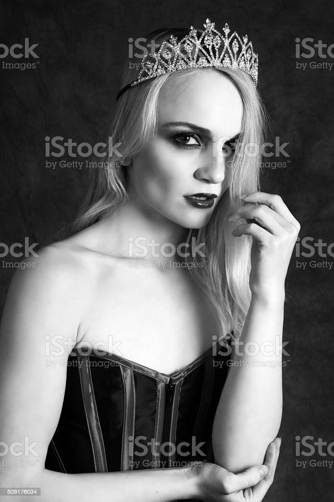 Evil queen,B&W waist up in crown looking worried. stock photo