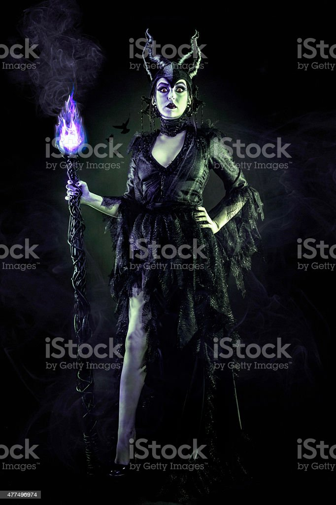 Evil Sorceress in Black Gown and Magic Staff stock photo