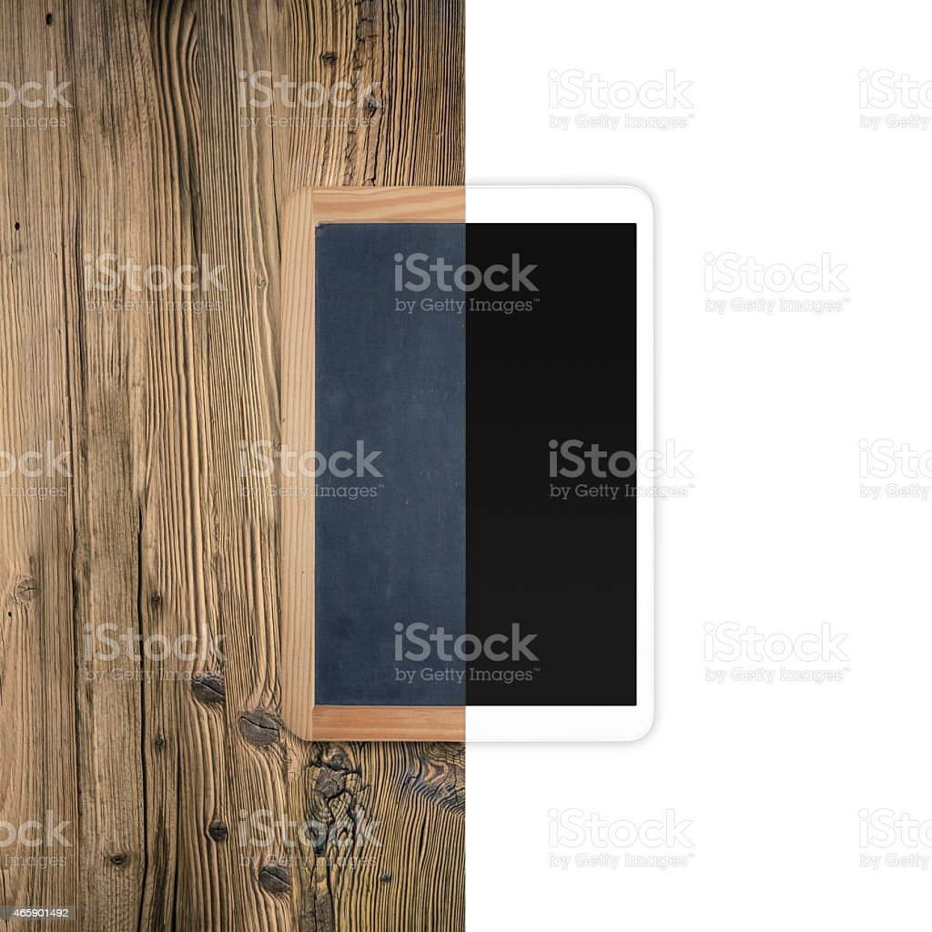 evolution of electronic - vintage blackboard and tablet pc stock photo
