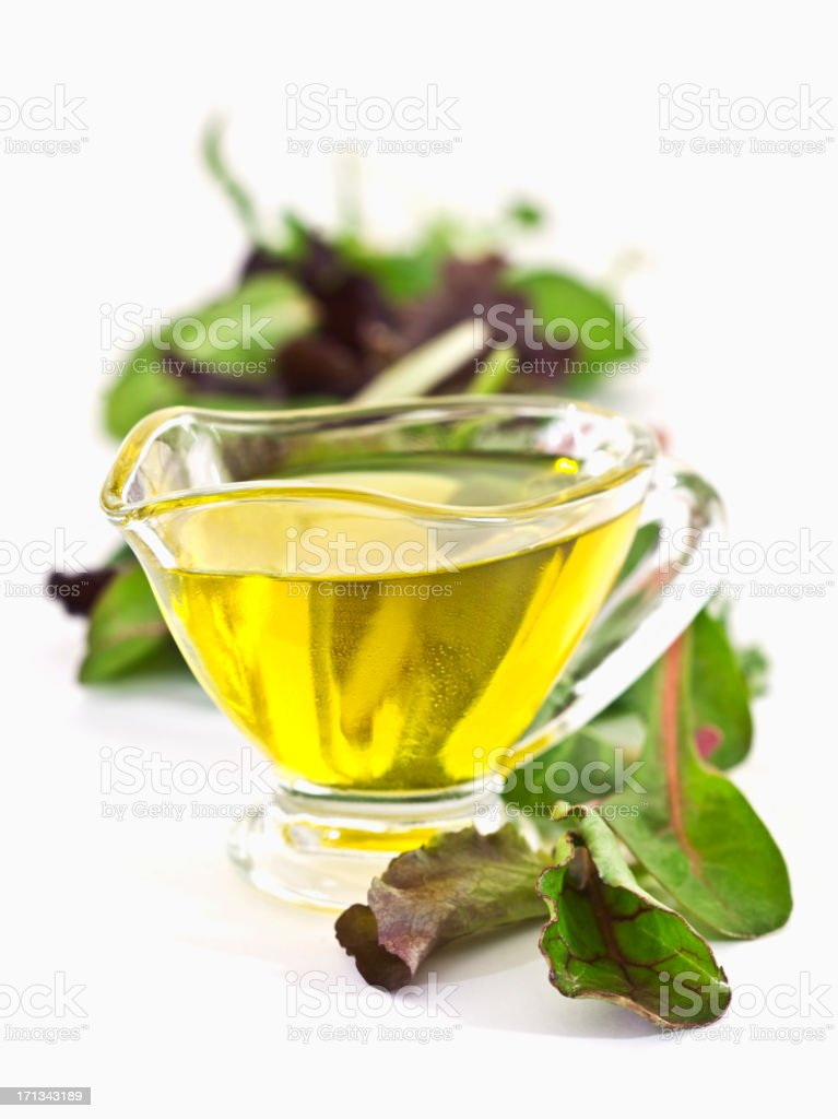 evoo and baby salad leaves stock photo