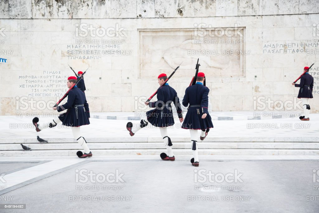 Athens, Greece - April 14, 2015: Evzones guarding in front of the Greek Parliament Building stock photo