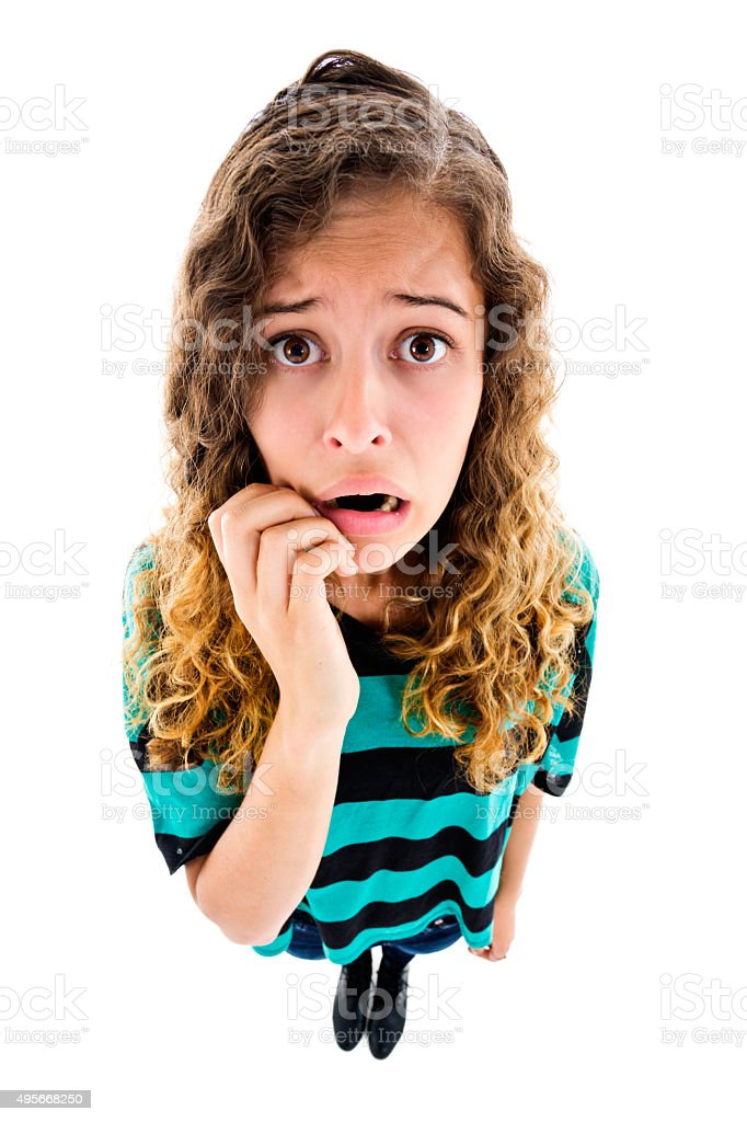 Exaggerated, high-angle, fisheye view of cute but worried young woman stock photo