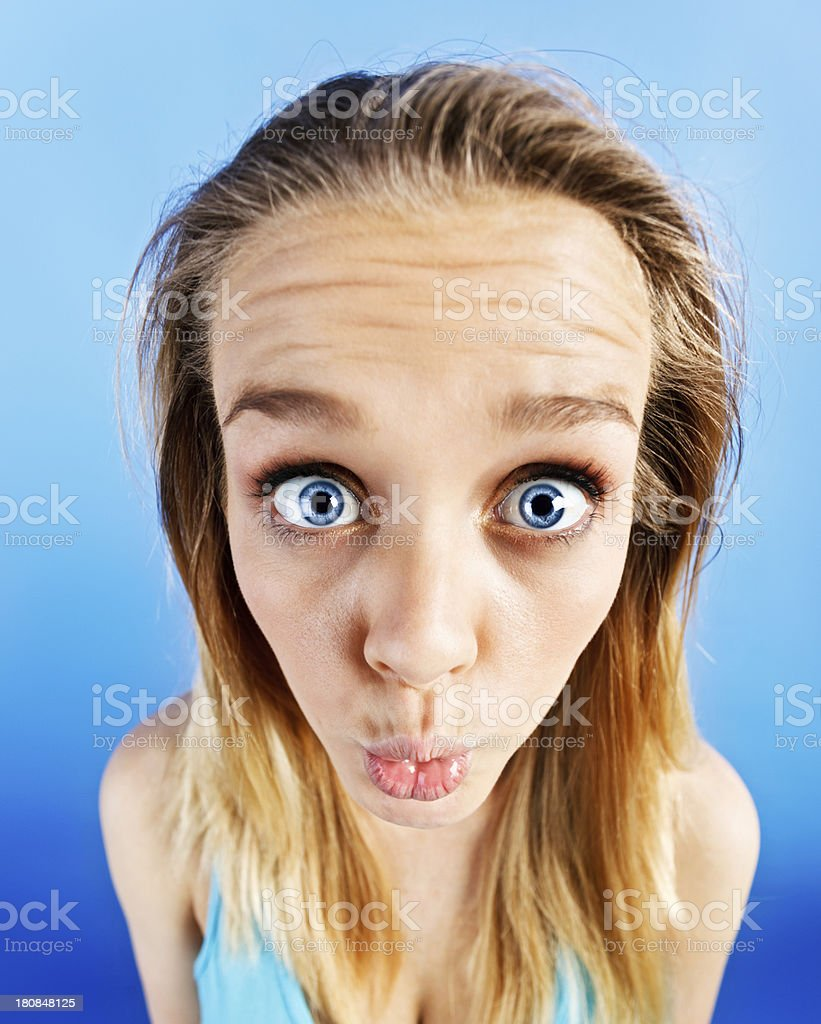 Exaggerated view of wide-eyed teenager with puckered lips royalty-free stock photo