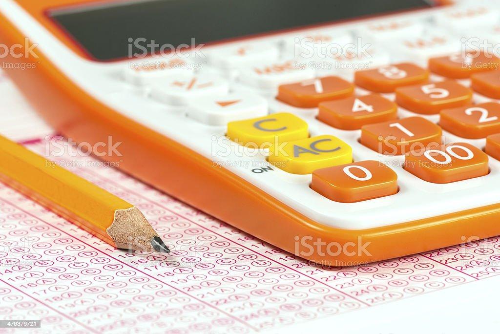 Exam and calculator stock photo
