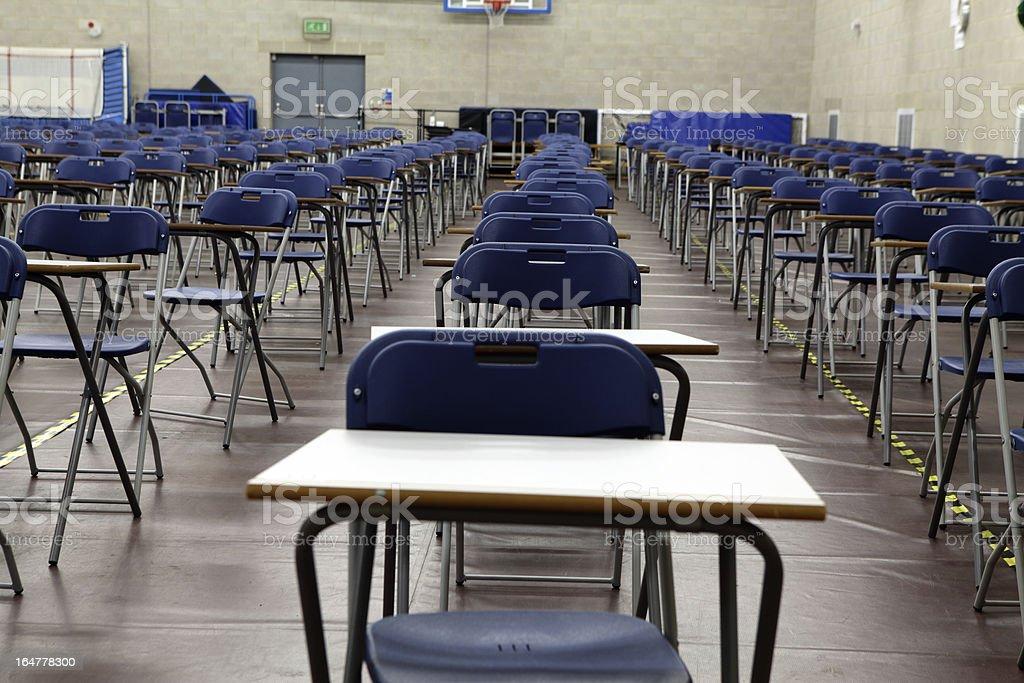 Exam hall desks and chairs stock photo