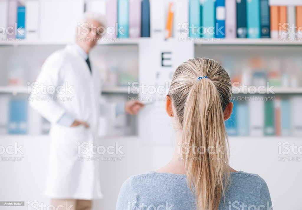 Exam with an eye doctor stock photo