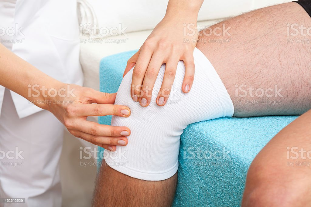 Examination of knee stock photo