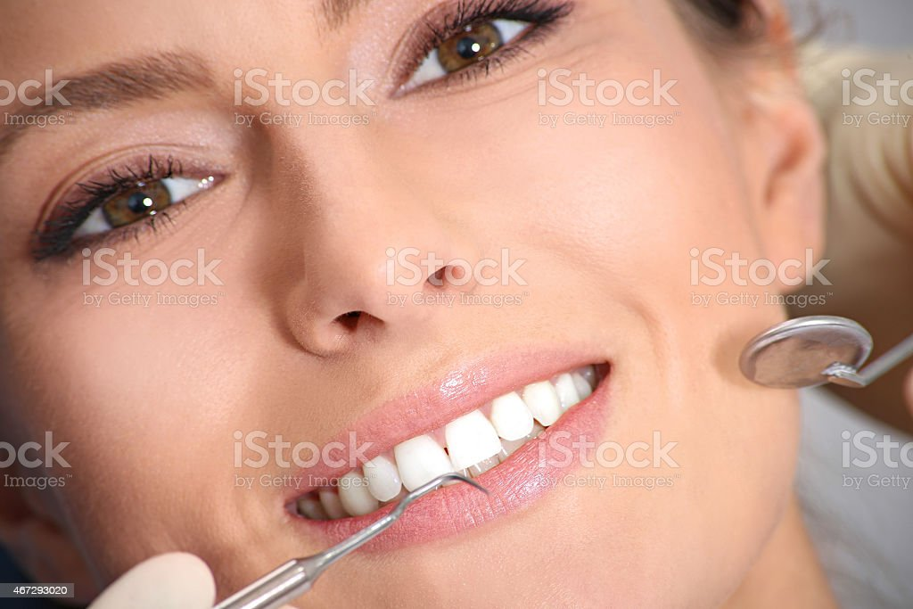 examination of the teeth in the office of the dentist stock photo