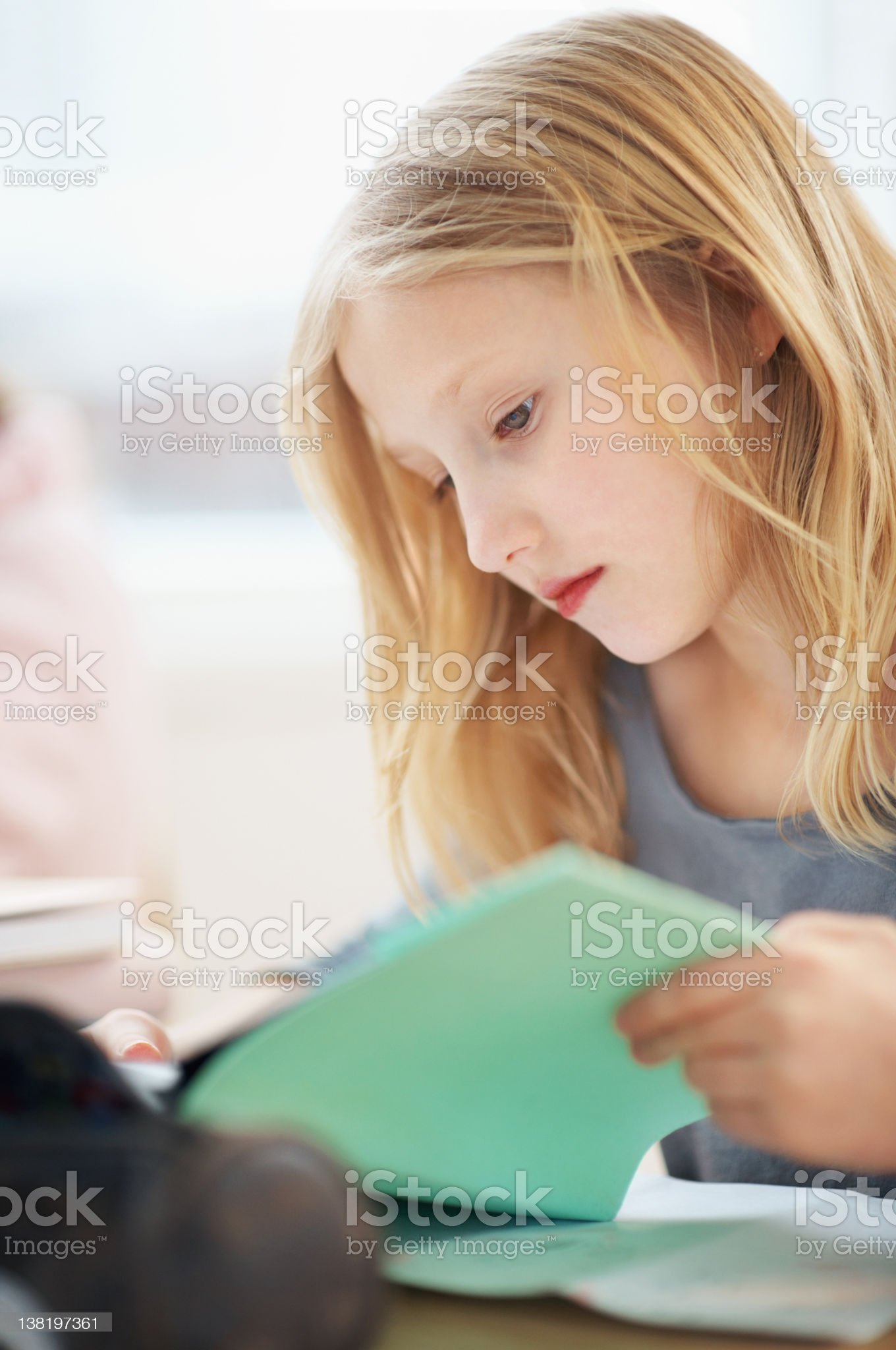 Examinations - School student concentrating on her studies royalty-free stock photo