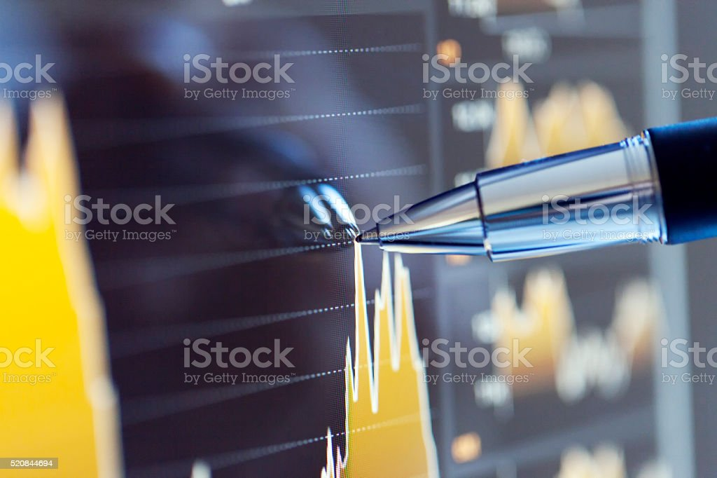 Examining a Business Graph on Computer Screen stock photo