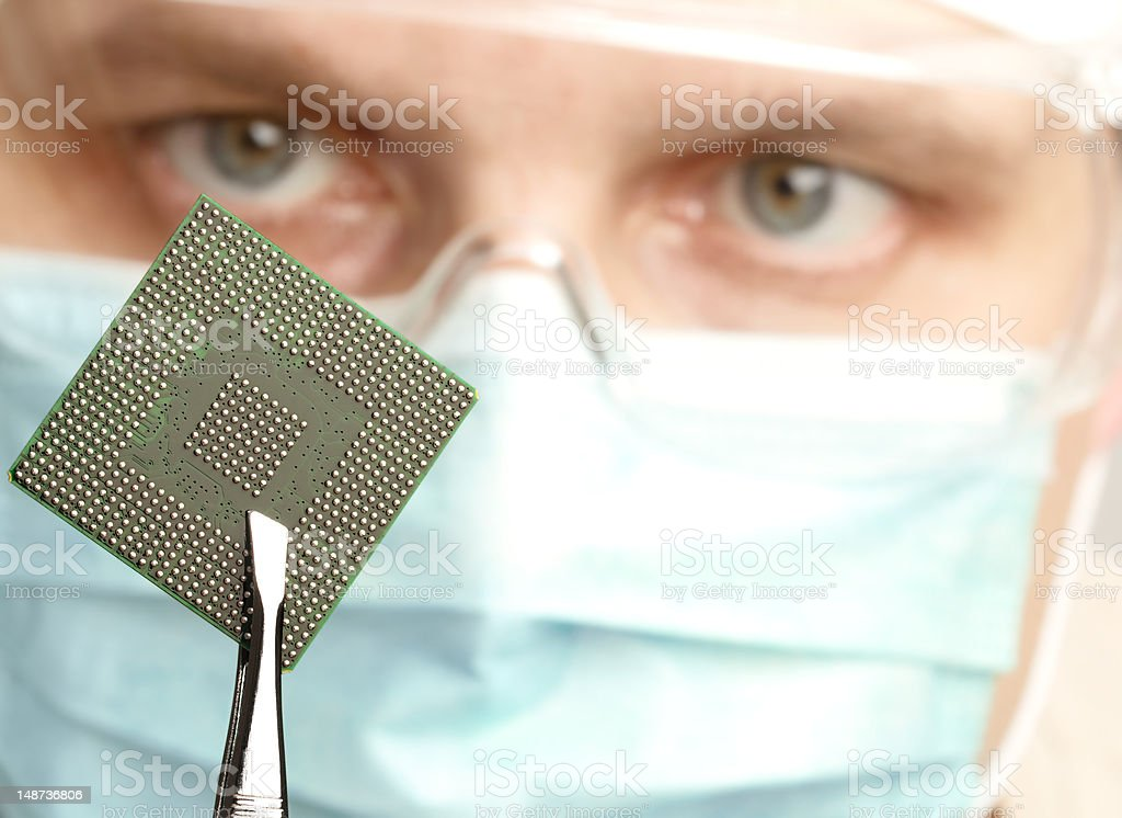 Examining a microchip stock photo