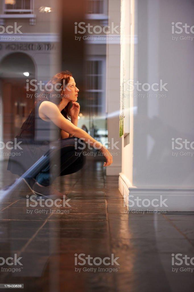 Examining an abstact work stock photo