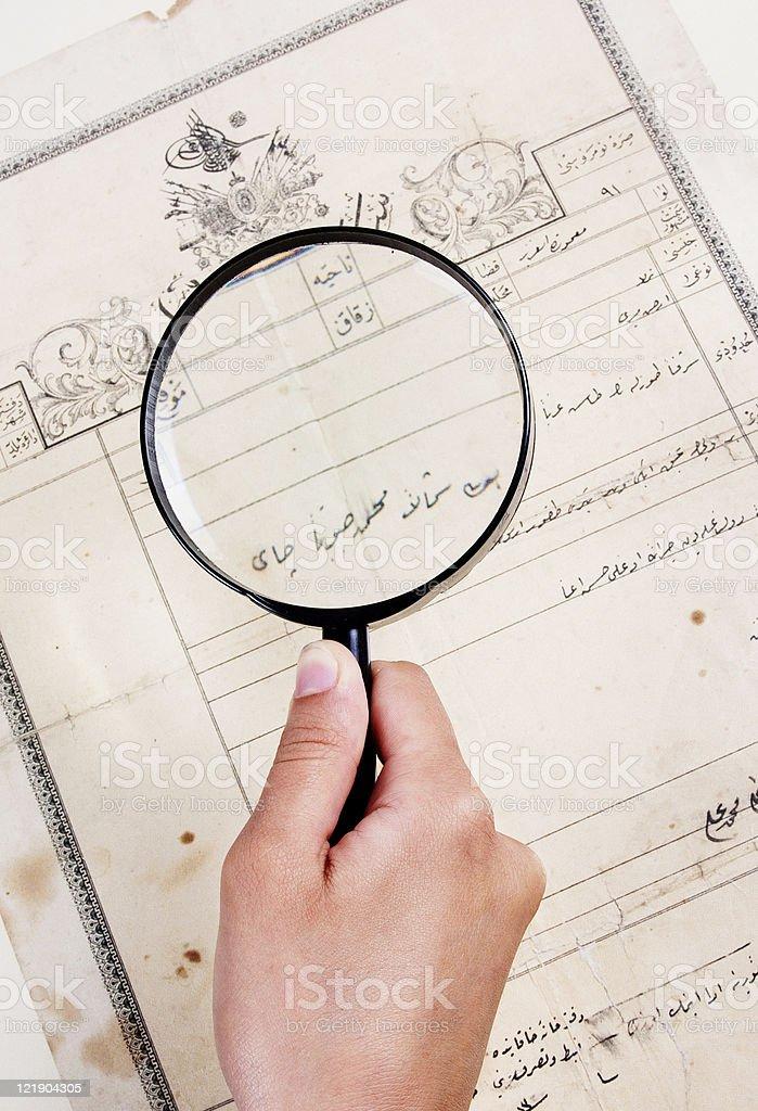 Examining ancient document stock photo
