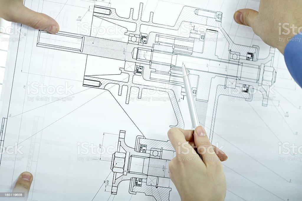Examining blueprint royalty-free stock photo