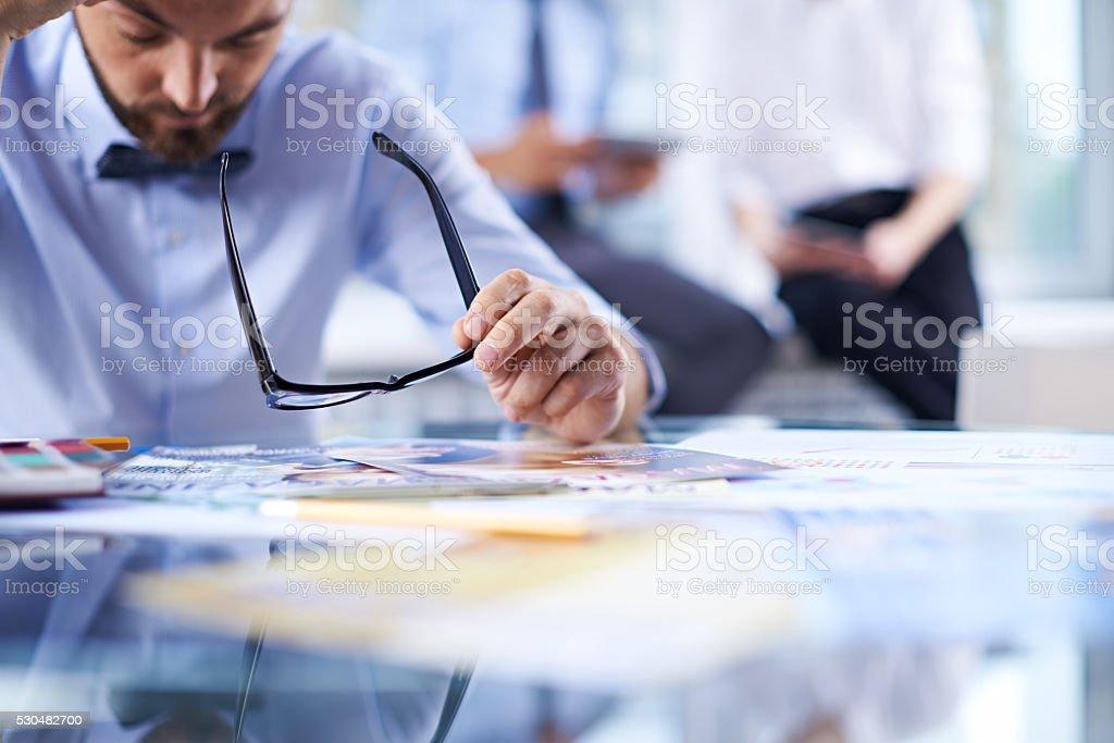 Examining brochures stock photo