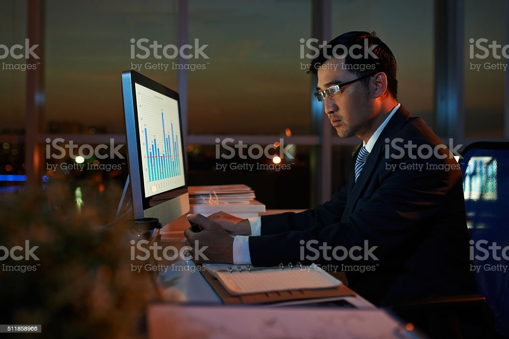 Examining business chart stock photo