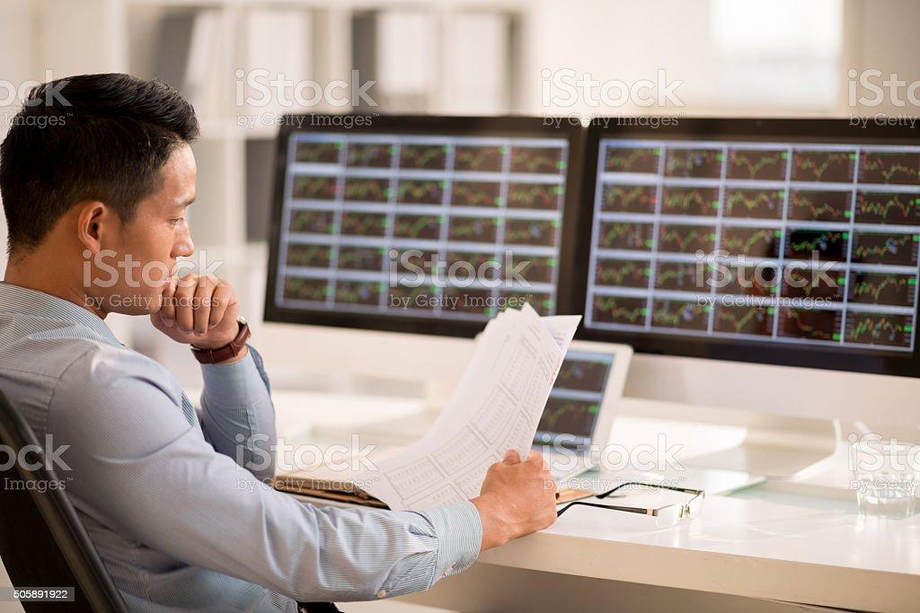 Examining business data stock photo