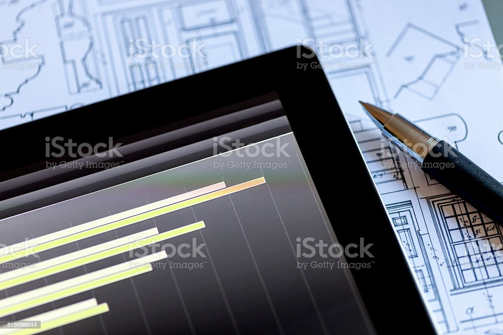 Examining Business Market Flow on a Digital Tablet stock photo