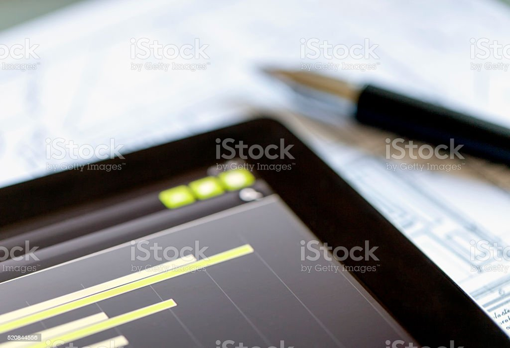 Examining Business Market on a Digital Tablet stock photo