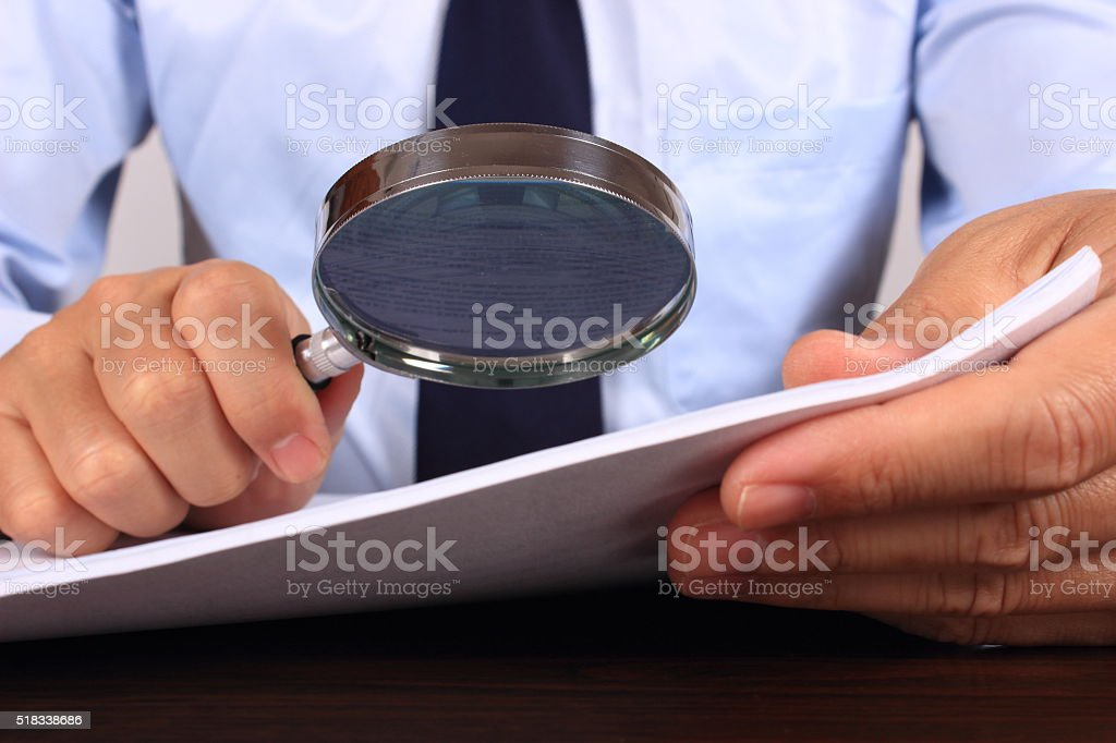 Examining document stock photo