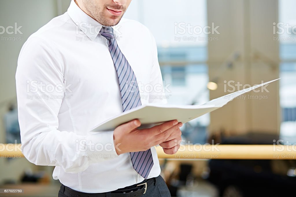 Examining documents stock photo