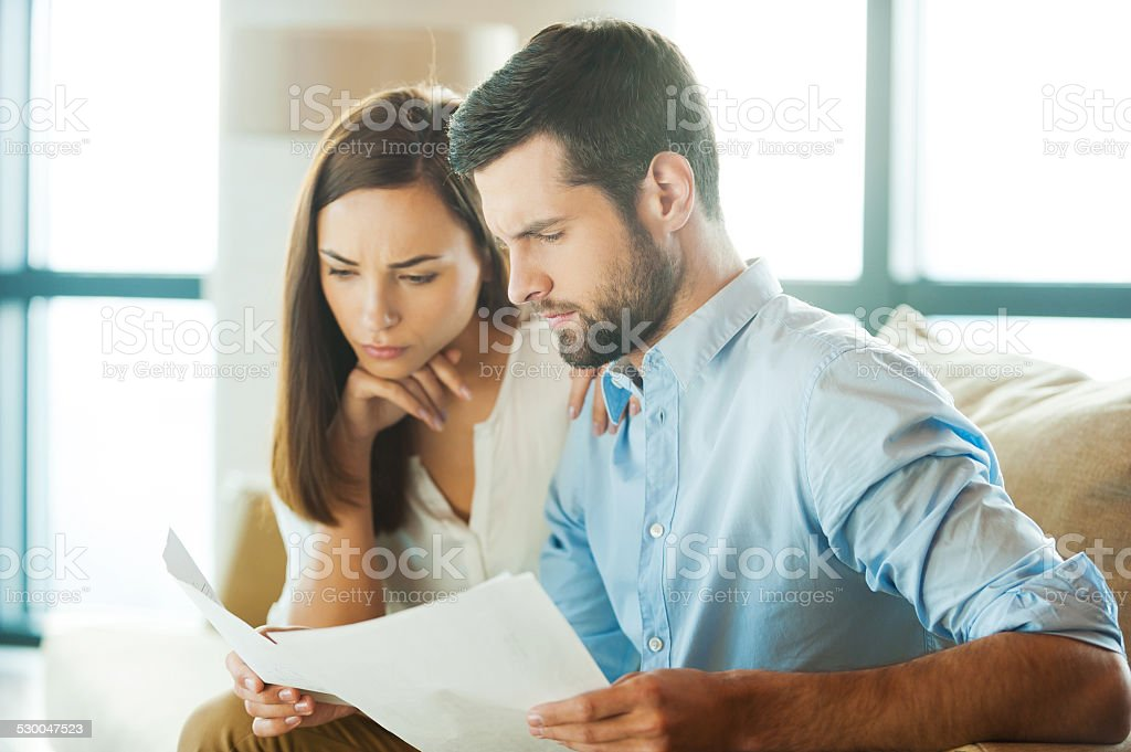 Examining documents together. stock photo