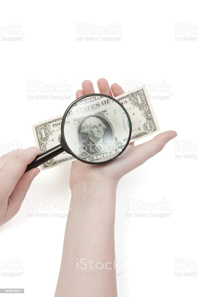 Examining dollars royalty-free stock photo