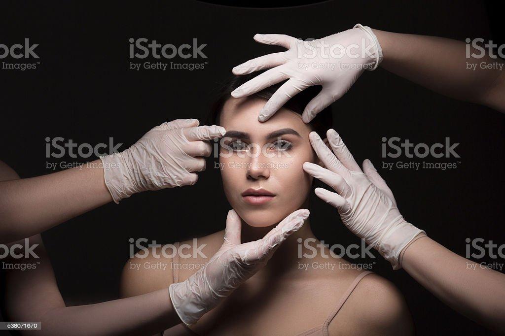 Examining face concept stock photo