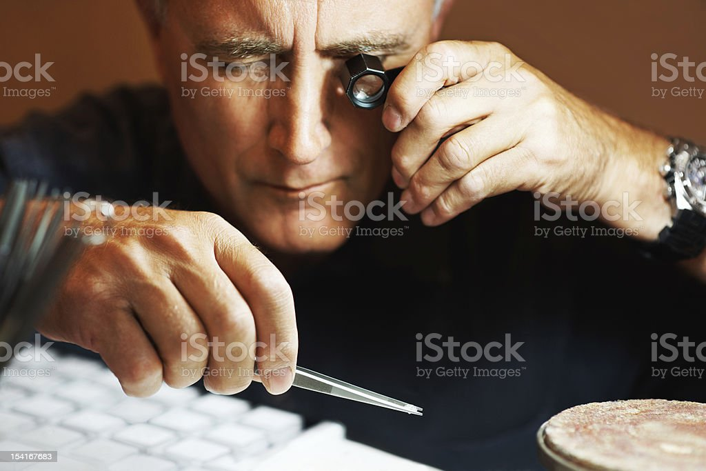 Examining for flaws royalty-free stock photo