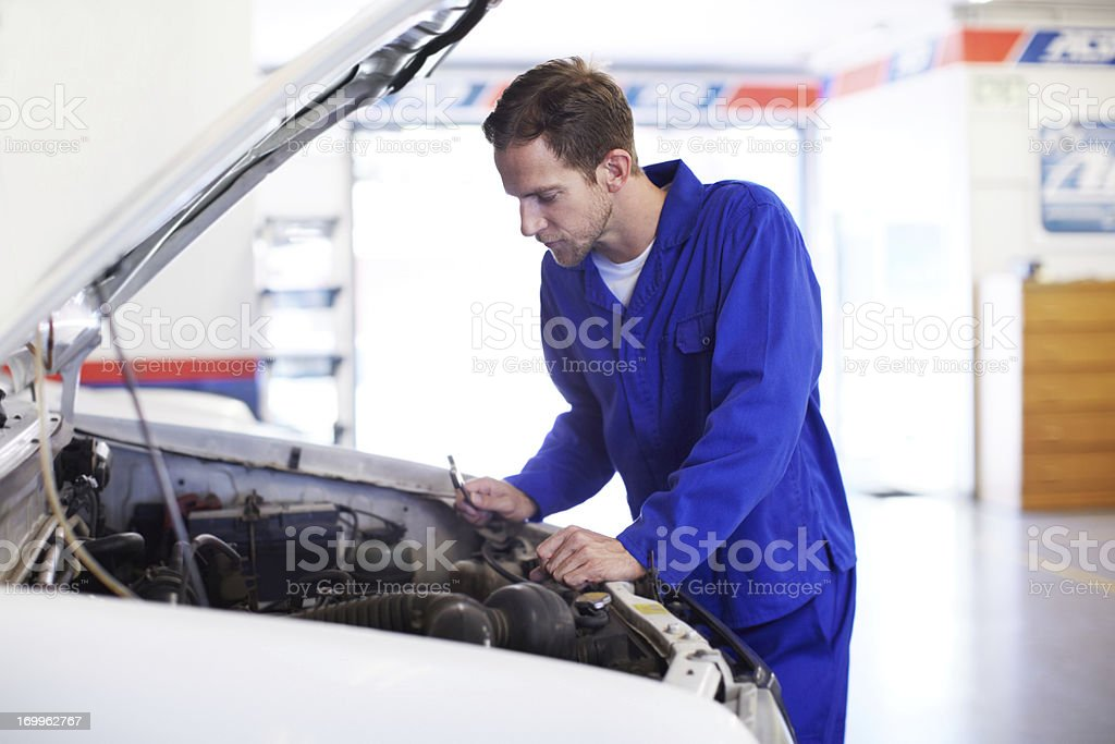 Examining for problems royalty-free stock photo