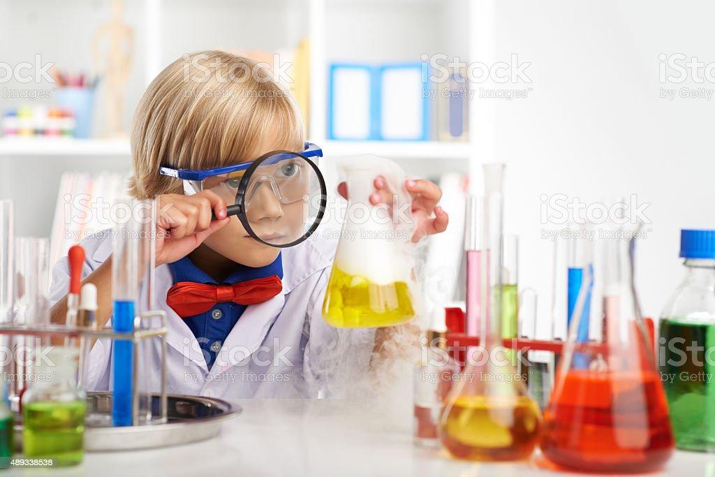 Examining fuming acid stock photo