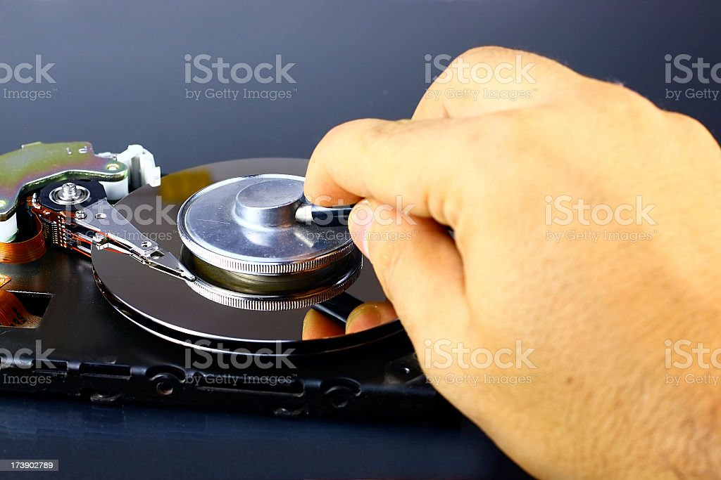 Examining hard drive royalty-free stock photo