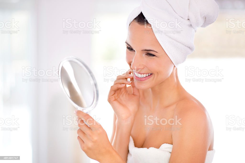 Examining her beautiful skin stock photo