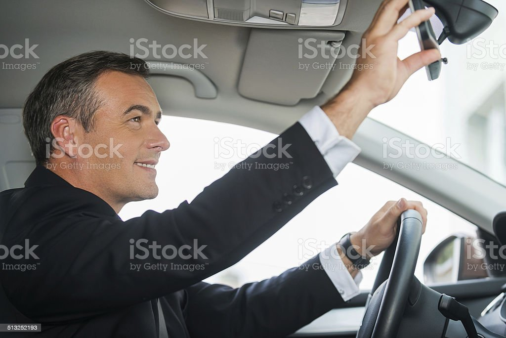 Examining his new car. stock photo