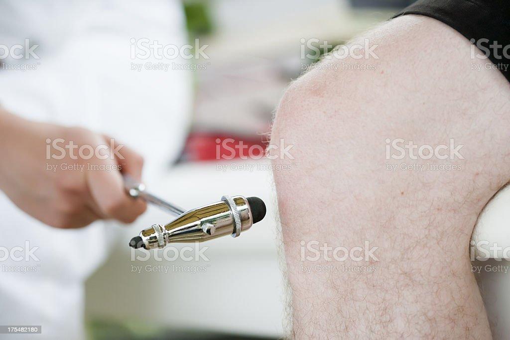 Examining knee reflexes stock photo