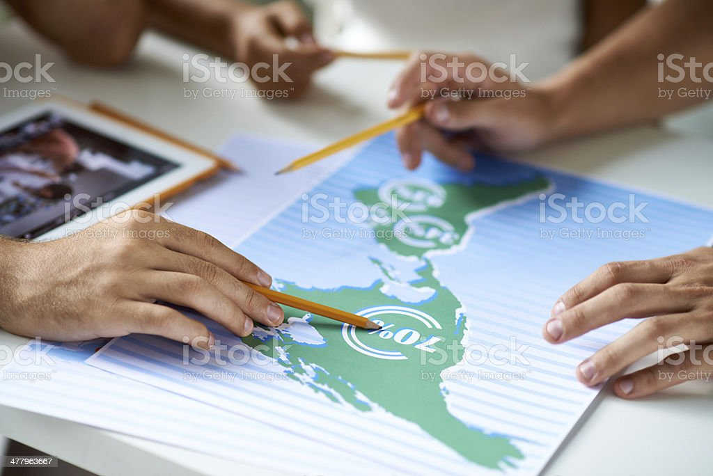 Examining map with financial figures royalty-free stock photo