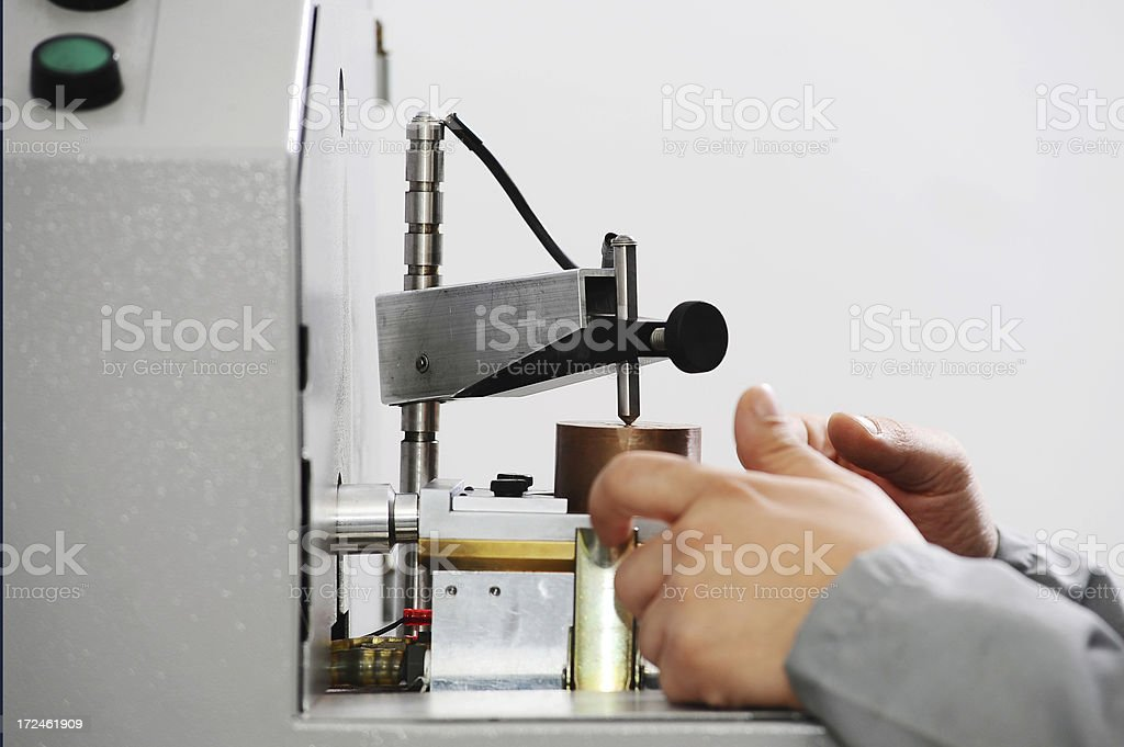 Examining metal quality in lab royalty-free stock photo