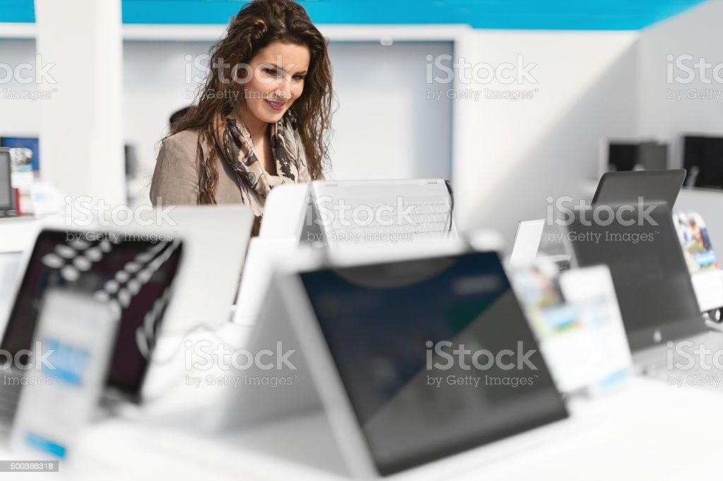 Examining new laptop stock photo