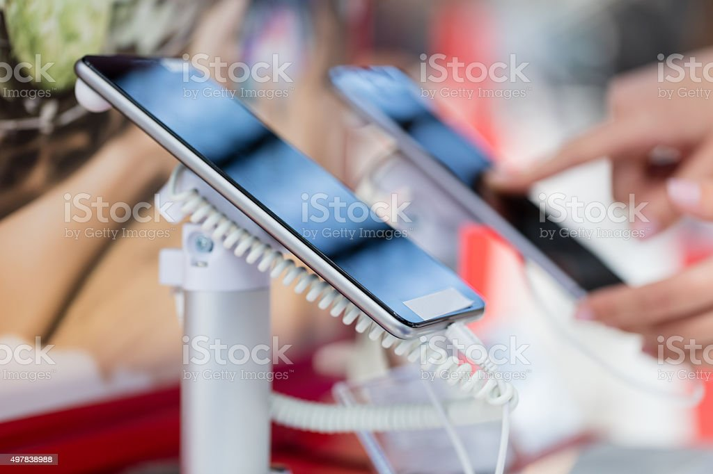 Examining smart phone stock photo