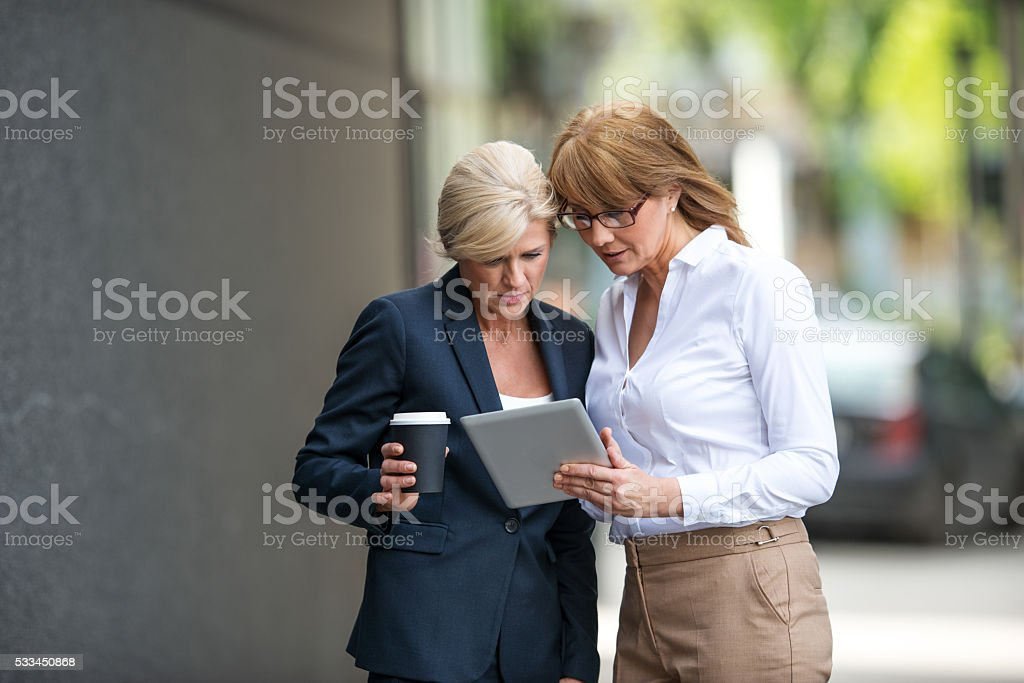 Examining their business plan stock photo