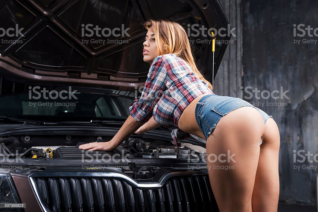 Examining your car. stock photo