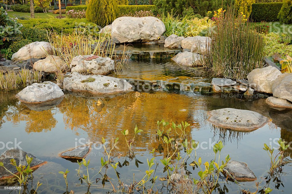 example of landscaping with stream stock photo