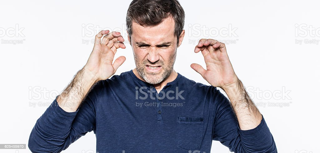exasperated young bearded man expressing aversion or disgust wit stock photo