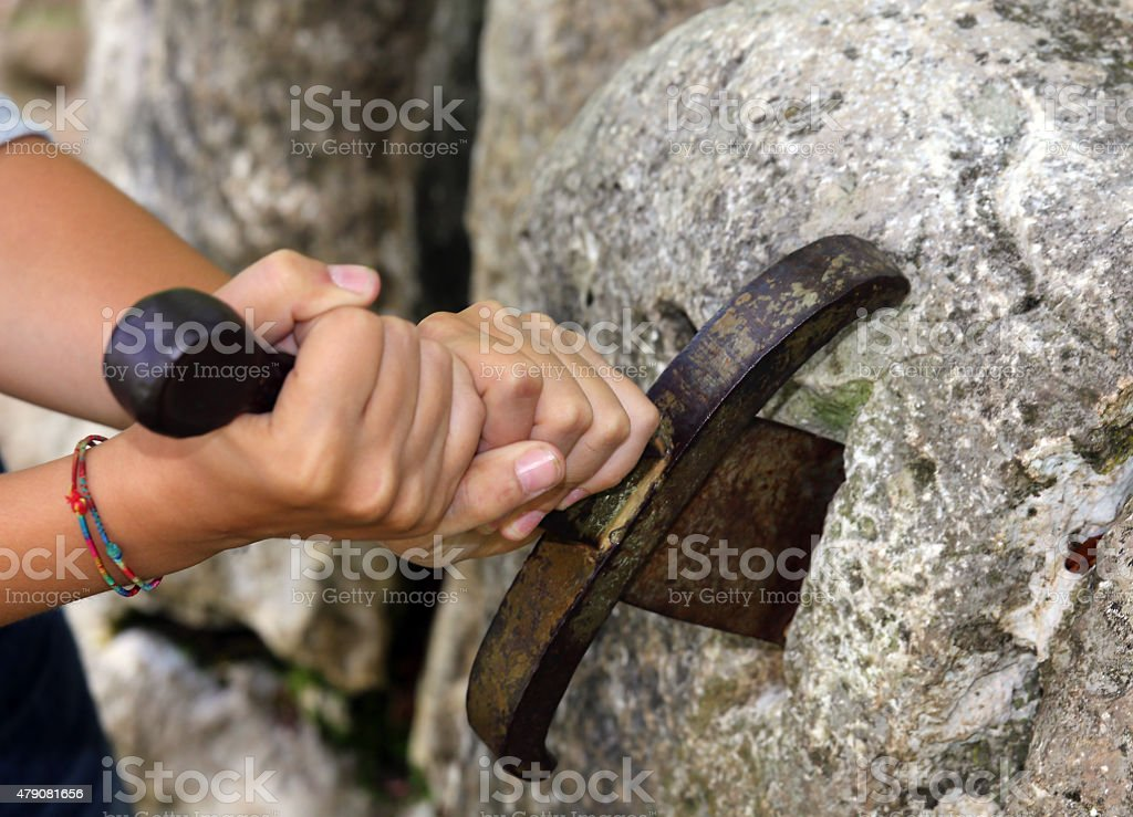 excalibur the famous sword in the stone stock photo