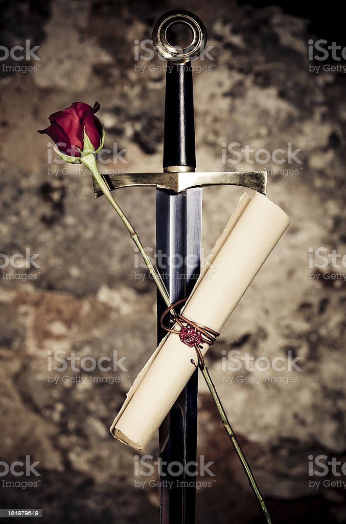 Excalibur with rose and scroll royalty-free stock photo