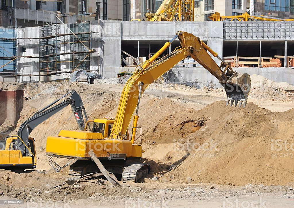 Excavating machine on construction site stock photo