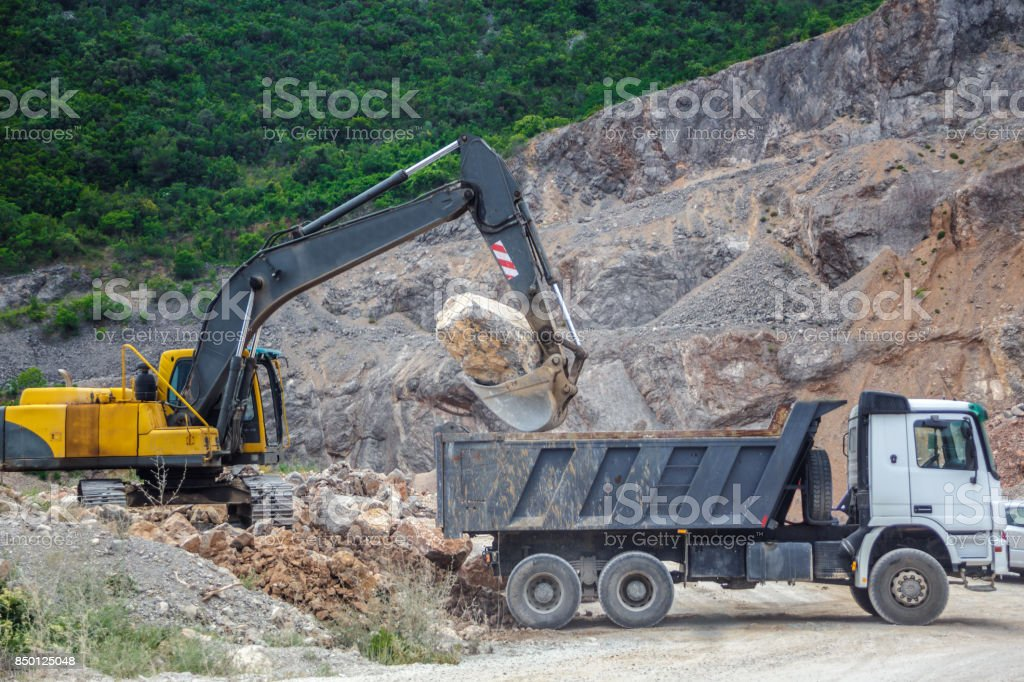 excavation in the mountains stock photo