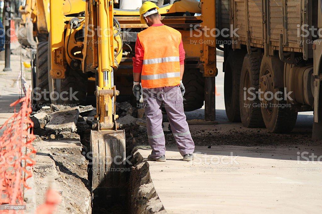 Excavation On Asphalt Road stock photo